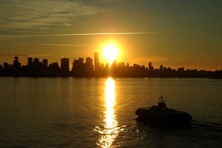 Beautiful Vancouver sunset with the sea bus in the foreground Stock Photo