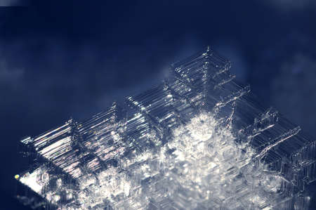 Hexagonal lattice of ice crystals formed on a cold winter day Stock Photo
