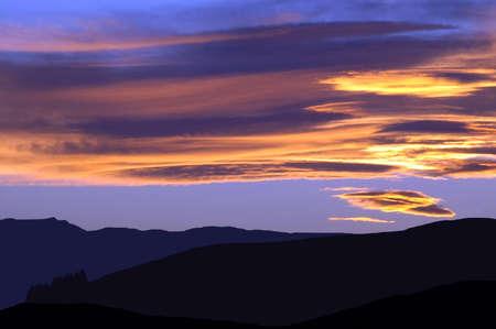 Sundown over terraces in South Canterbury Stock Photo