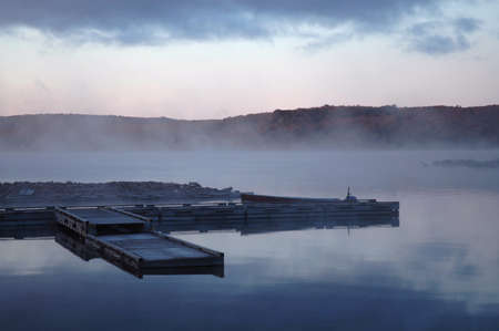 Dock in the mist at sunrise on Flack lake, Ontario