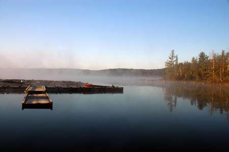Dock at sunrise on Flack lake, Ontario