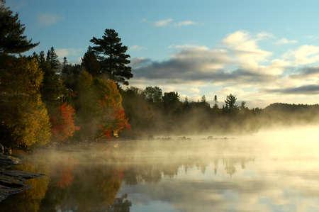 Calm bay at sunrise on Flack lake, Ontario