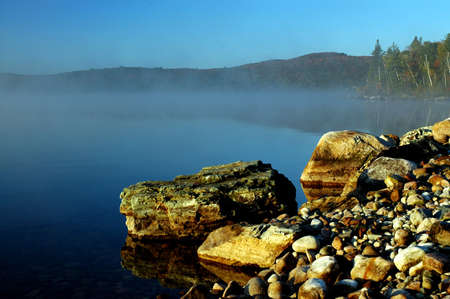 Rocky shoreline on a lake in Ontario at sunrise Stock Photo