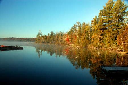 Fall trees sunrise over beautiful lake, Ontario