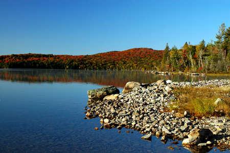 flack: Stony beach and sunrise over Flack lake, Ontario