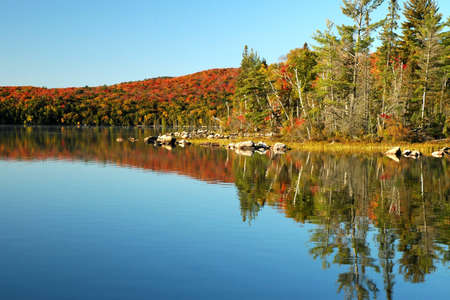 Beautiful reflections in the fall on Flack lake, Ontario Stock Photo