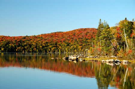 Autumn reflection on Flack Lake, Ontario