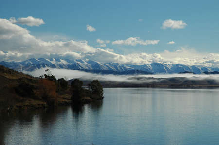 The Southern Alps of New Zealand with lake in the foreground