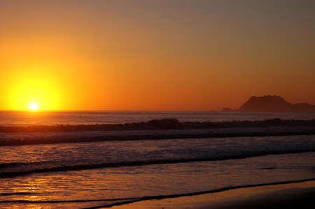 Sunrise Sunrise over the surf on New Zealand beach on January 1, 2005, Tokumaru Bay