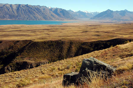 Rock and ravine at Lake Tekapo in the Mackenzie Country, South Island, New Zealand Stock Photo