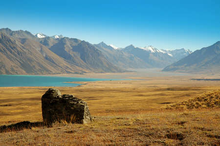 tekapo: Lone rock at Lake Tekapo in the Mackenzie Country, South Island, New Zealand Stock Photo