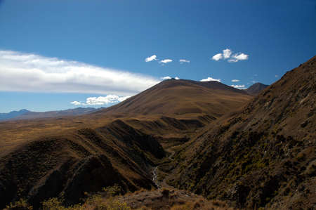 River valley and hills in the Mackenzie Country, South Island, New Zealand Stock Photo