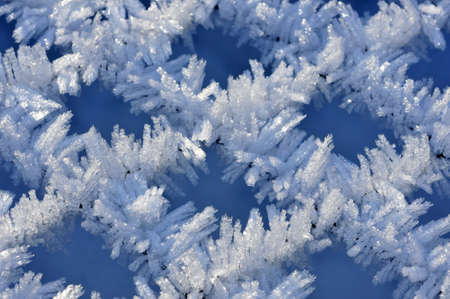 Fine ice crystals on netting formed by hoar frost Stock Photo