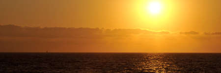 Panoramic sunset with sailboat on the horizon in Mexico