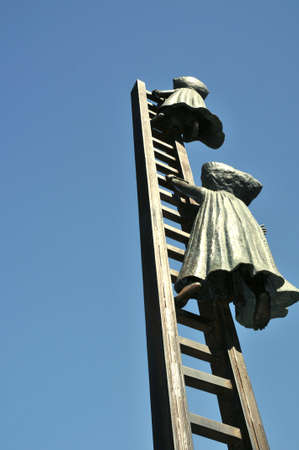 Climb up a ladder to nowhere, brass sculpture, Mexico Stock Photo