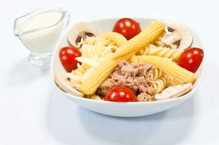 Traditional French dish made with fresh tomato mushrooms with corn on a white plate Reklamní fotografie