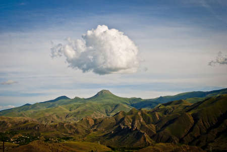 Mount Vardablur in Vayots Dzor, you can see the Vayots Dzor mountain range and the village of Agarakadzor: 스톡 콘텐츠