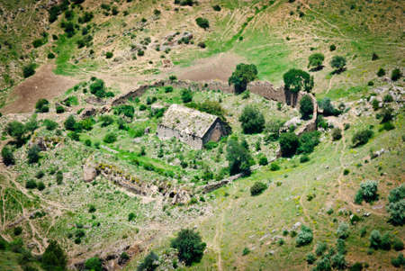 St. Zion Church stands next to a gorge in the high mountains in the medieval walls 스톡 콘텐츠