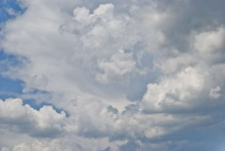 in a large white interesting form the cloud is seen about the approach of rain in the sky above the blue color 스톡 콘텐츠