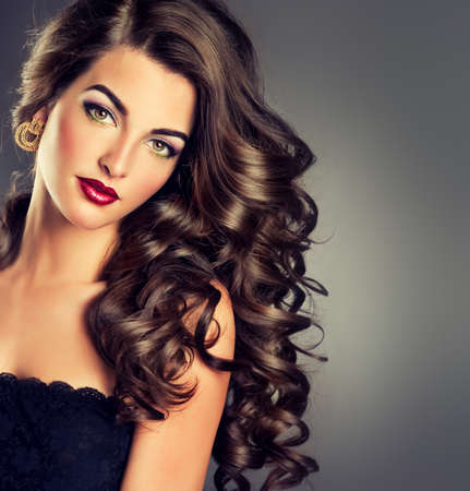 feeling up: Beautiful model brunette with long curled hair
