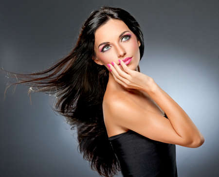 glamour hair: Model with flying hair and trendy makeup