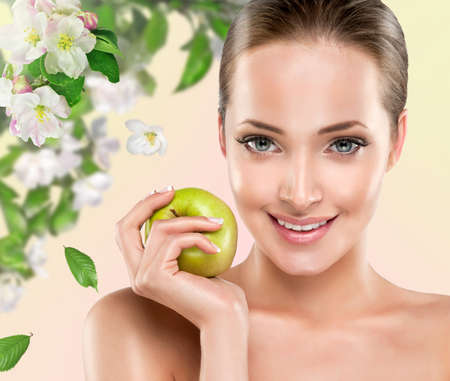 woman apple: Young girl smiling holding a green Apple. Health & beauty Stock Photo