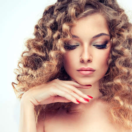 beautiful bangs: Model with curly hair
