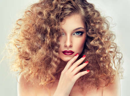 long red hair woman: Model with curly hair