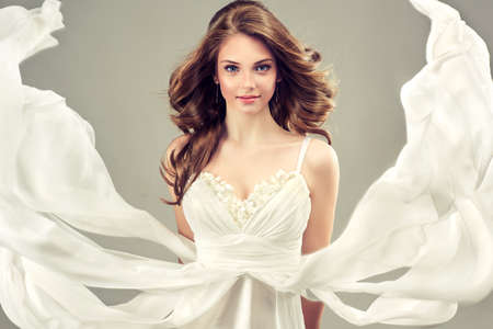 wedding accessories: Girl model in a white wedding dress with elegant hairstyle