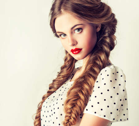 modern portrait of pretty girl with two pigtails