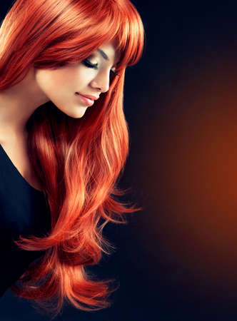 color hair: Fashion Girl with beautiful and shiny red hair.Model with long curly red hair