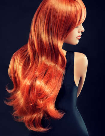 long curly hair: Fashion Girl with beautiful and shiny red hair.Model with long curly red hair