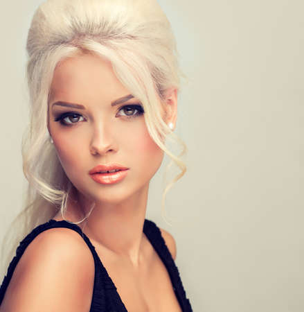 long curly hair: Beautiful model with retro hair style bouffant hair and a bushy tail Stock Photo