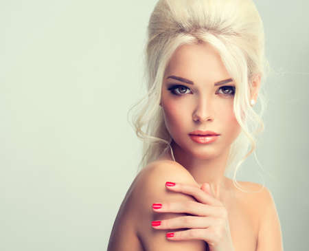 hair curl: Beautiful model with retro hair style bouffant hair and a bushy tail. Red nails manicure