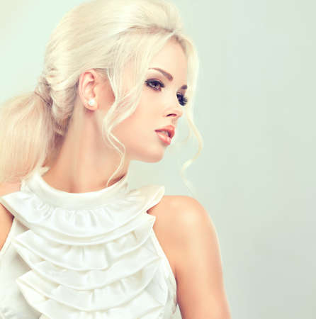 bouffant: Beautiful model  with retro hair style , bouffant hair, and a bushy tail Stock Photo