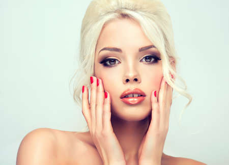 bright lipstick: Beautiful model  with retro hair style , bouffant hair, and a bushy tail  . Red nails manicure Stock Photo