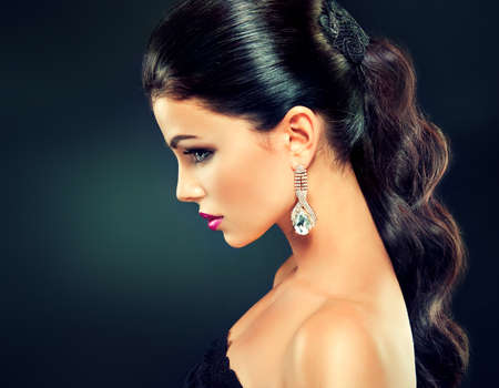 earings: Model with long curly tail and fashionable earrings