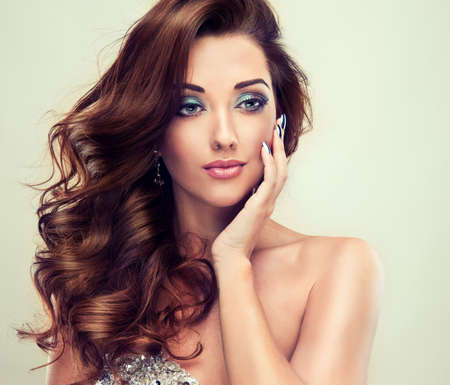 silver hair: Beautiful model with long curly hair fashion makeup and silver nails Stock Photo