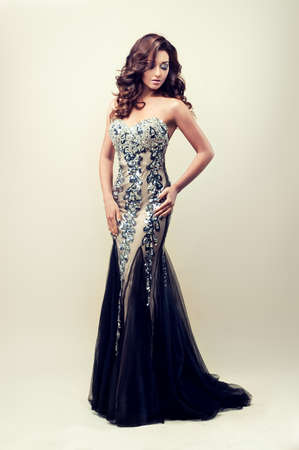 Beautiful lady in silver evening dress