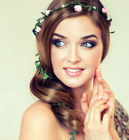 natural make up: Beautiful girl with a wreath of flowers on her head. Spring and summer look Stock Photo