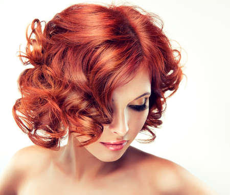 red nail colour: pretty redhaired girl with curls Stock Photo