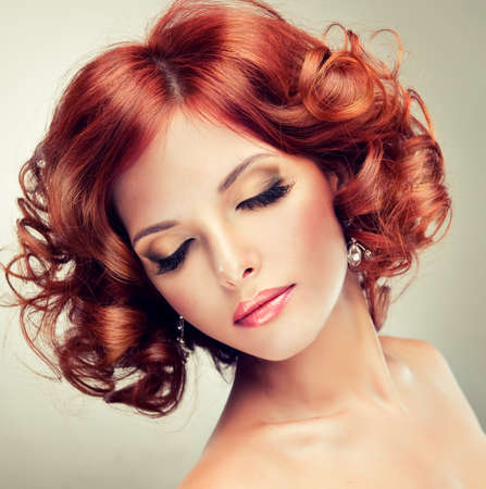 pretty redhaired girl with curls photo