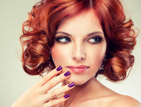 bang: pretty redhaired girl with curls and fashionable makeup