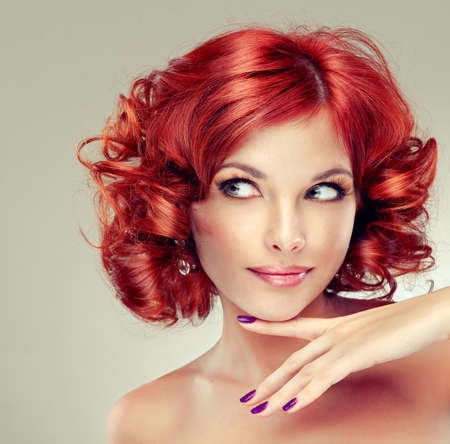 pretty redhaired girl with curls and fashionable makeup