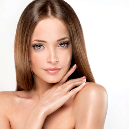 straight up: Beautiful girl with brown hair. Long straight hair Shine with health.