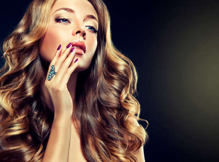 hair curl: Luxury fashion style manicure cosmetics and makeup hair Stock Photo