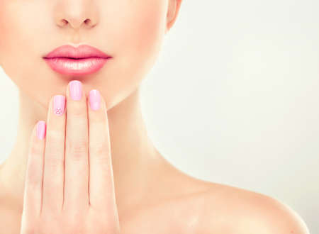 pink nail polish: Beauty Spa and cosmetics Woman Portrait. Beautiful Girl with pink manicure on the nails