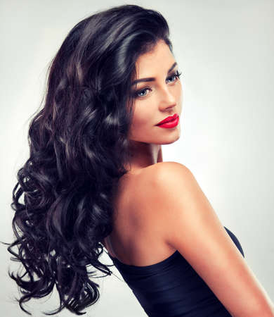 lip colour: Model brunette with long curly hair