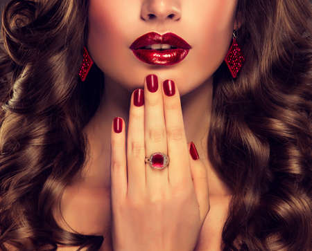Bright red Makeup and nail Manicure and curly hair