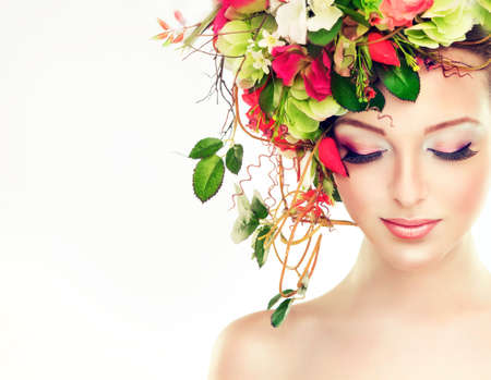 Spring or summer freshness. Girl with delicate pastel flowers in hair Archivio Fotografico